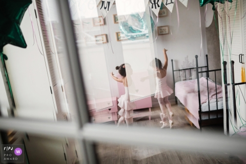 Saint-Petersburg family photojournalist created this image of two young girls practicing ballet in matching pink tutus