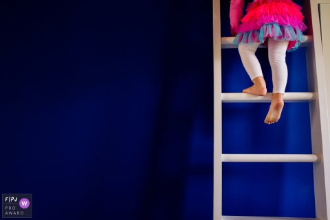 Key West family photojournalist captured this photo of a little girl in a pink and purple tutu carefully climbing a ladder in her bare feet