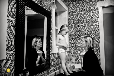 This black and white photo of a toddler and her mom having a conversation after a bath was captured by a Key West family documentary photographer