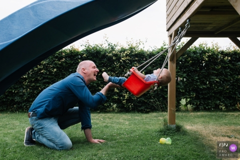 A father pushes his baby boy on a swing in this FPJA award-winning image captured by an Utrecht, Netherlands family photographer.