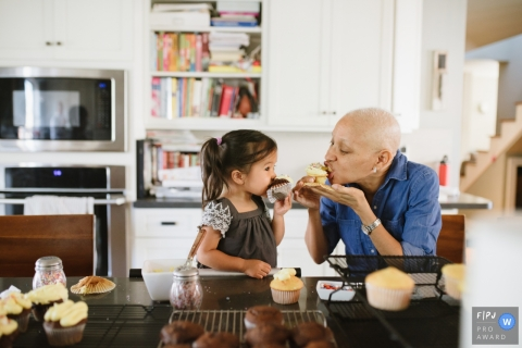 A grandmother eats cupcakes with her granddaughter in this Family Photojournalist Association contest awarded photo created by a Los Angeles, CA family photographer.