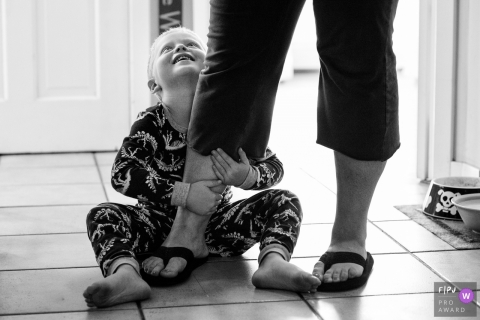 A son holds onto his mother's leg in this family picture by a Key West, FL photographer.