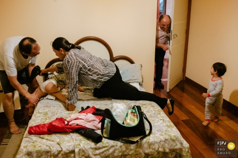 Florianopolis family photojournalist captured this photo documenting the struggles of getting toddlers ready to go