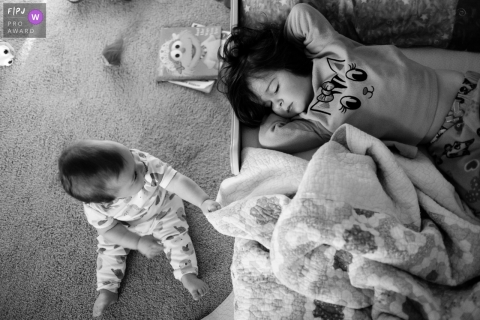 Atlanta family photography session with napping toddler and baby with a blanket.