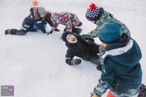 Five boys play outside in the snow together in this family picture by a Saint Petersburg, Russia photographer.