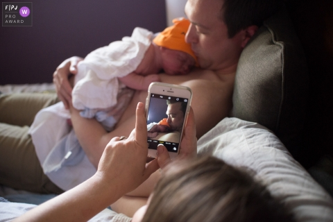 Florida birth photography - Time to text the family to let them know of a new arrival!