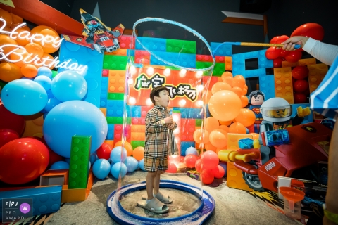 Zhejiang family photography | This image may contain: bubbles, party, kids, children, birthday, Legos, balloons, balls