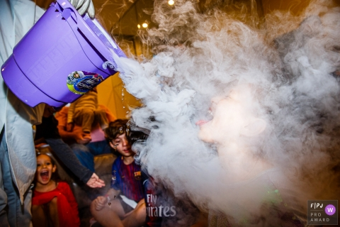 Sao Paulo kids party photography in Brazil of dry ice fog on a kids face.