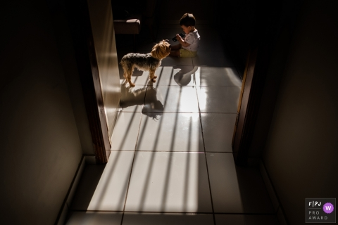 Pernambuco documentary family photo session - Recife boy and his best friend, the dog.