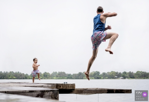 Florida family photographer - jumping off docks at the lake.