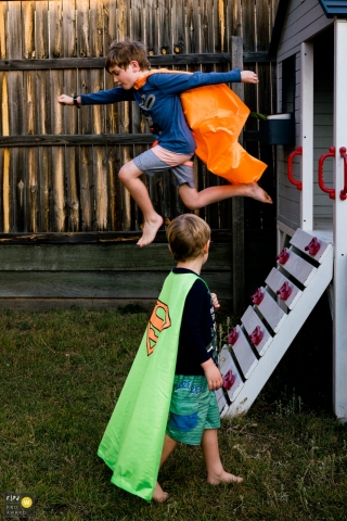 Kent England family photography from the backyard | Two boys playing superheroes