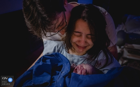 Mato Grosso mother crying as she holds her baby for the first time. Brazil birthing pictures.