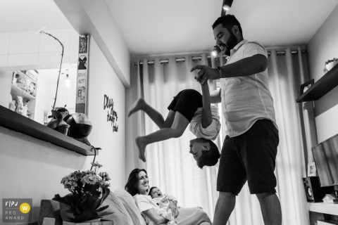 Father playing with his son in the living room | Sao Paulo Family Session