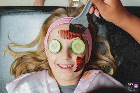 Young girl enjoys a day at the spa with cucumbers on eyes | Sao Paulo Family Session
