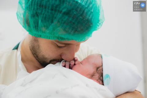 A father cuddles with his newborn baby | Sao Paulo Birth Photography