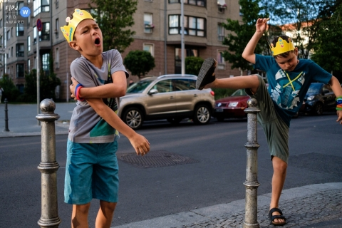 Boys play on the streets of Berlin on a family outing | Germany Family Photographer