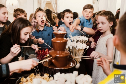 Children enjoy marshmallows and a chocolate fountain at a birthday party | Russia Party Photographer