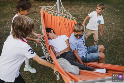 Shuvalovka Family Photography | Kids having fun on a hammock