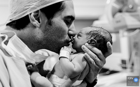 Curitiba Parana new dad kisses his newborn baby at the Hospital Santa Cruz