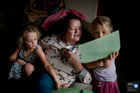 Dorset Family Photojournalism | Sisters showing their mother their drawings
