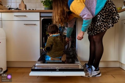 Noord HollandNetherlands child inside the dishwashing machine - Helping my mom