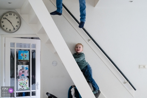 Zuid Holland Netherlands Boy is just hanging around the stairs at home