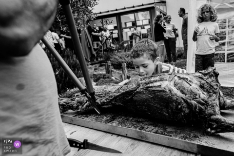 Haute-Garonne Occitanie boy checking on a roasted pig - what does it taste like?