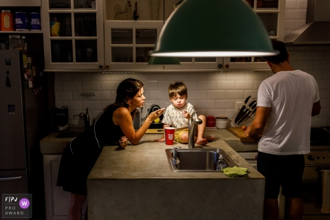 Sao Paulo Brazil boy and family preparing Saturday breakfast in the kitchen