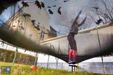 Dusseldorf North Rhine-Westphalia Girl on a trampoline jumping in the backyard