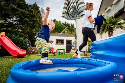 Dusseldorf North Rhine-Westphalia little boy Getting wet in the pool