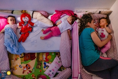 Rio Grande do Sul Brazil mom sleeping with her kids in the baby room