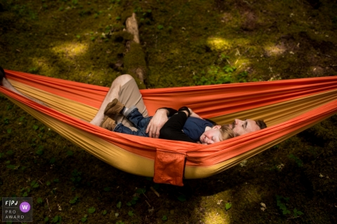 Washington United States father and son sleep in hammock while camping