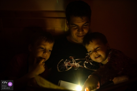 Budapest Hungary family evening tale reading time with flashlights
