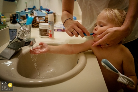 Key West Florida child brushing teeth while getting ready for bedtime