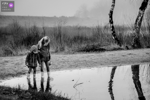 Flanders family photographer captures children checking out a pond during their family walk
