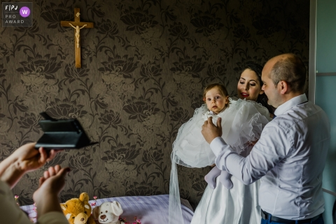 A young girl and family ready themselves for a baptism | Belgium baptism image