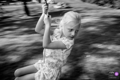 Nantes Family Photographer captures girl flying on a zipline.