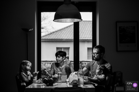 Scene of a family meal that looks like a painting | Savoie Family Photography