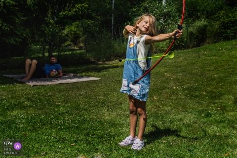 Limburg Family photo of girl misfiring the arrow