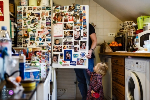 Paris Documentary Family image of the fridgerator door open and a toddler taking a peek