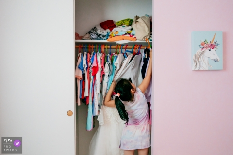 Chicago Family image of a girl looking in her closet for the perfect dress to wear