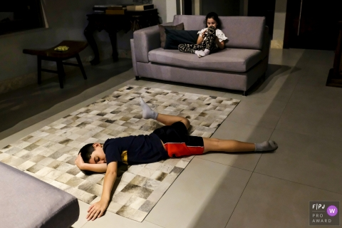 Minas Gerais Documentary Family Photography | young man exhausted and sprawling himself out on the floor