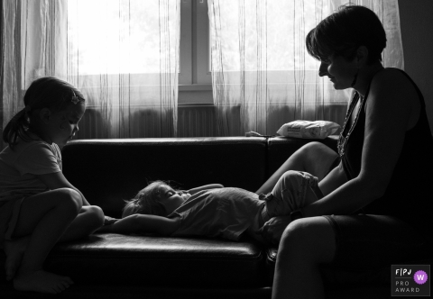 Gard Documentary Family Photographer | mother changes diaper, an everyday moment