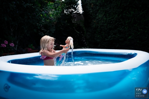 Nimes Documentary Family Photography | girl in the pool with her doll