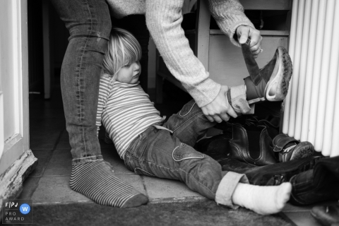 Cambridgeshire Documentary Family picture of mum taking girl's shoes off