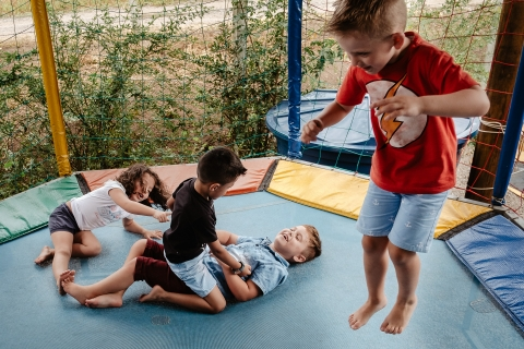 children playing on the trampoline on a children's birthday.