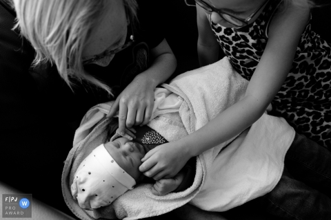 Overijssel Family photography of a brother and sister meeting their new baby sister