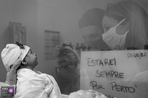 Newly born baby is shown through the windows of the nursery at the hospital as the visitors look upon him at Pro Matre