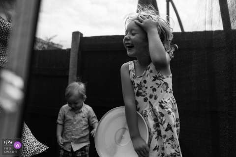 Bath, Somerset outdoor family photographer captured the pure joy of children playing in a trampoline in the UK