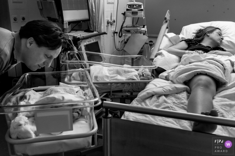 Isala hospital documentary birth photography showing Mom is out after a exhausting c-section while dad can't stop looking at his girls